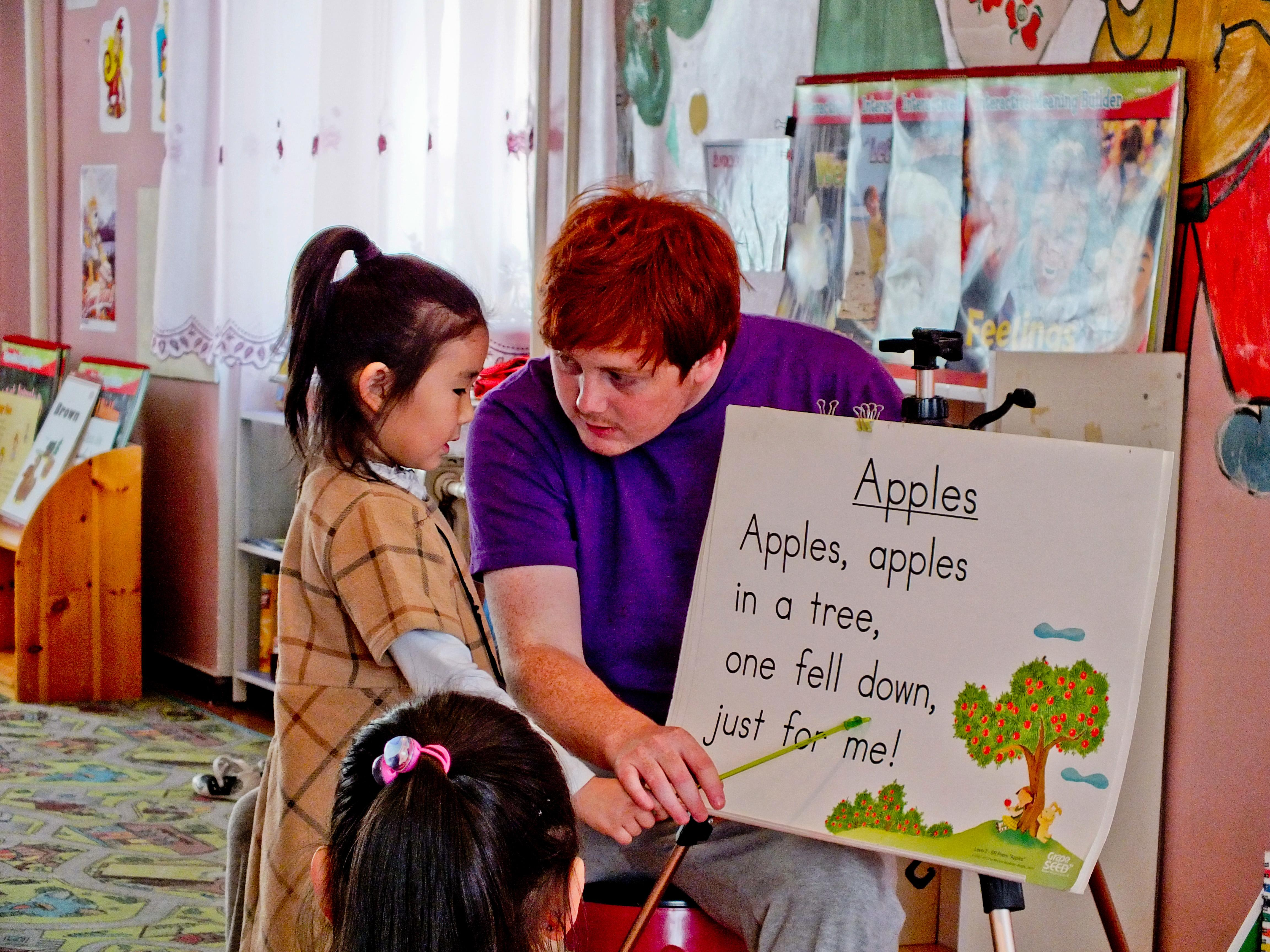 A young girl learns how to say an English phrase at our volunteer teaching placements in Mongolia